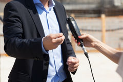 Media interview. Hand gestures. Journalist making interview with businessman or politician. Body language Royalty Free Stock Photos