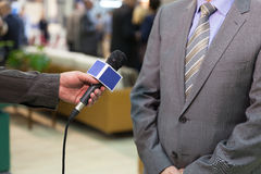 Media interview. Journalist making interview with businessman or politician Stock Photo