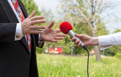 Media interview. Journalist making interview with businessperson or politician Royalty Free Stock Photos
