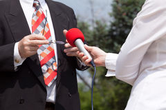 Media interview. Journalist. Microphone. Royalty Free Stock Photography