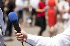 Media interview. With the microphone Stock Image