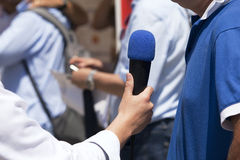 Media interview. With the microphone Stock Photo
