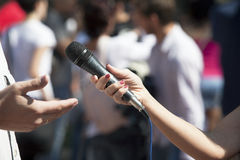 Media interview. With the microphone Royalty Free Stock Images