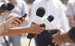 Media interview. With the microphone Royalty Free Stock Photos