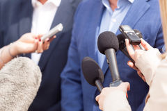 Media interview. Press conference. Microphones. Stock Photo