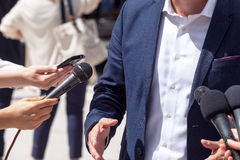 Media interview. Press conference. Spokesman. Royalty Free Stock Images
