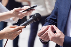 Media interview. Press interview. Reporter holding a microphone conducting an TV or radio interview Royalty Free Stock Photo