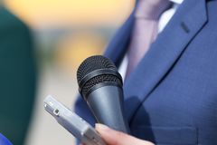 Media interview. Public relations - PR. Microphone. Press or media interview. News conference. Broadcasting journalism Stock Photos