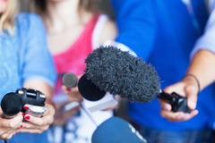 Media interview. Reporters. Microphones. News conference. Media event. Journalism Royalty Free Stock Photography