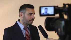 Media interview. TV camera recording media interview