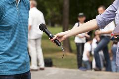 Media interview. TV or radio reporter interview Royalty Free Stock Photography