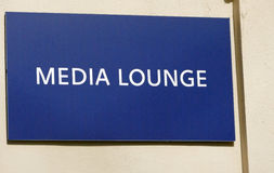 Media lounge sign on a wall royalty free stock images