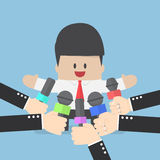 Media microphones held in front of business man Stock Image