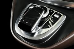 Media and navigation control buttons of a Modern car. Car interior details. Brown leather interior with stitching of the luxury mo. Dern car. Modern car interior royalty free stock photography