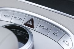 Media and navigation control buttons of a Modern car. Car interior details. White leather interior of the luxury modern car Stock Photo