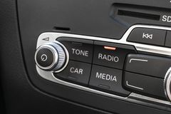 Media and navigation control buttons of a Modern car. Car interior details. Black leather interior of the luxury modern car. Moder stock photography