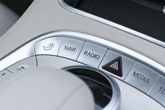 Media and navigation control buttons of a Modern car. Car interior details. White leather interior of the luxury modern car Royalty Free Stock Photo