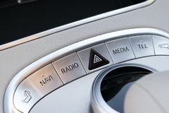 Media and navigation control buttons of a Modern car. Car interior details. White leather interior of the luxury modern car Stock Photography