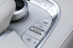 Media and navigation control buttons of a Modern car. Car interior details. White leather interior of the luxury modern car. Royalty Free Stock Photography