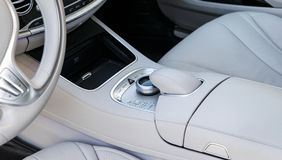 Media and navigation control buttons of a Modern car. Car interior details. White leather interior of the luxury modern car. Royalty Free Stock Images