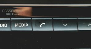 Media and navigation control buttons of a Modern car. Car interior details stock images