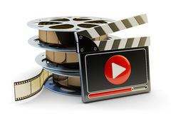 Media player and video clips production concept. Stack of film reels and clapper board with play button on white background Stock Image