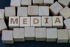 Media, social media press and news concept, cube wooden block with alphabet combine the word Media on black chalkboard background.  royalty free stock photo