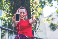 Media song music concept- Funny girl listening music. Media song music concept- Funny young girl listening music royalty free stock photos