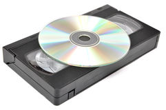 Media storage. Still life with DVD and video tape Royalty Free Stock Photos