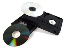 Media storage. Still life with DVDs and video tapes Royalty Free Stock Photos