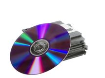Media Storage. A stack of old dusty 3 1/2 disks and a compact disk, or dvd leaning up against them Royalty Free Stock Photography