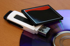 Media Storage Devices. Three different pieces of media storage. (USB stick, compact flash and a DVD Royalty Free Stock Photography