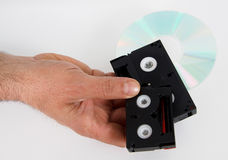 Media storage video cassettes tapes cd hand hold. Media storage video cassette tapes cd Stock Image