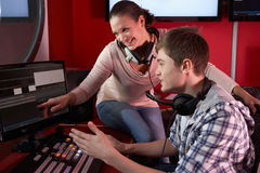 Media Student With Tutor Working In Film Editing Class Royalty Free Stock Image
