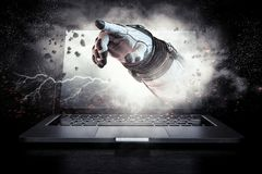 Media technology in space. Mixed media. Hand of astronaut coming out of laptop screen. Mixed media Royalty Free Stock Photos