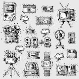 Media technology vintage icons set. Symbols of media technology in vintage style. Multimedia digital icon set: camera, gamepad and tv, floppy disk and watch Royalty Free Stock Image