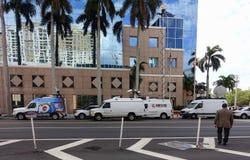 Media trucks surround Broward School Board building. stock photo