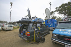 Media vans set up in dirt parking lot, CSU- Dominguez Hills, Los  Angeles, CA Royalty Free Stock Photos