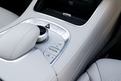 Media volume and navigation control buttons of a Modern car. Car interior details. White leather interior of the luxury modern car Royalty Free Stock Photos
