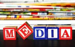 Media word. Near many newspapers Stock Photos