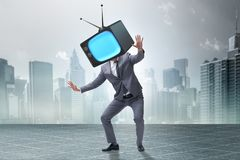 The media zombie concept with man and tv set instead of head Stock Photos