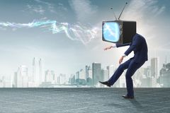 The media zombie concept with man and tv set instead of head. Media zombie concept with man and tv set instead of head Royalty Free Stock Image