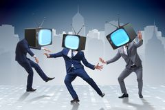 The media zombie concept with man and tv set instead of head. Media zombie concept with man and tv set instead of head Stock Photos