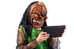 Media zombie by a tablet device Stock Photos