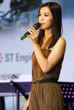 MediaCorp Artiste Rebecca Lim. Performing on stage during the RSAF Open House 2011 Royalty Free Stock Photography