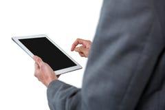 Mediados de sección del hombre de negocios usando la tableta digital Fotos de archivo
