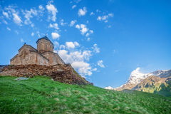 Mediaeval Church in mountains. Holy Trinity Church near Mount Kazbek in Georgia. Tsminda Sameba. Mediaeval Church in mountains Stock Photos