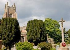 A Mediaeval English Church. An English village church with war memorial Stock Photo