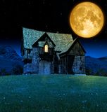 Mediaeval Fantasy Tavern in Moonlight. 3D rendering of a mediaeval fantasy tavern barn under a giant moon Stock Photography