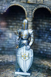 Mediaeval Knight statues in metal armor. Mediaeval Knight statues in the ancient metal armor, toys and models Royalty Free Stock Photography